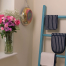Decorative timber ladders used as display stands in interior design and home styling