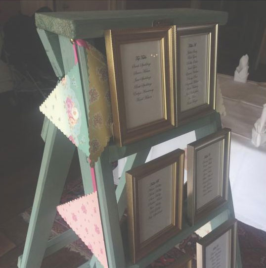 Step ladder wedding seating arrangement display - painted in Cuprinol Seagrass
